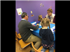 Eric Norris, state librarian, works on craft project with children