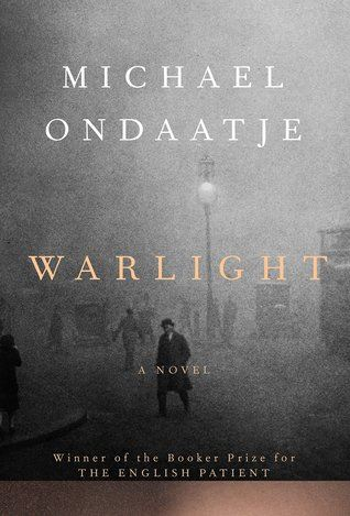 Warlight book cover. Grainy black and white photo of a 1940's street. A man stand in the center o